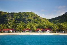 Caribbean Beach With Hotel Resort - Michael Utech/Getty Images