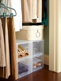 "Clear View ""Clear containers fit snugly below hanging garments in this small closet to provide storage and display space for favorite shoes. Keep the pairs you wear most frequently front and center."""
