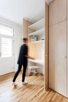 Clever storage surrounds window seat in flat by Atelier 111 Architekti