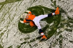 Miles the mascot of the Denver Broncos celebrates after defeating the New England Patriots 30-24 in overtime at Sports Authority Field at Mile High on November 29, 2015 in Denver, Colorado.