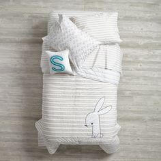 Shop Early Edition Kids Bedding (Bunny).  Our Early Edition Bedding is adorned with charming, stylized words, as well as a playful drawing of a bunny.  Mix and match pieces for your kids