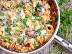 A fast and easy one skillet Creamy Spinach & Sausage Pasta that the whole family will love. Step by step photos.