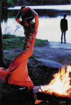 fire dancing in an orange dress