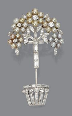 NATURAL PEARL AND DIAMOND JABOT PIN, circa 1930. The topiary motif decorated with clusters of small natural pearls in natural colors including light yellow and light gray, further decorated with 50 round, marquise-shaped, baguettes, and shield-shaped diamonds weighing a total of approximately 8.50 carats, mounted in platinum.