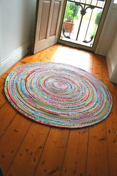 I LOVE the looks of this rug - I think I need one for my kitchen, and maybe the front hall as well! how to sew a fabric rug