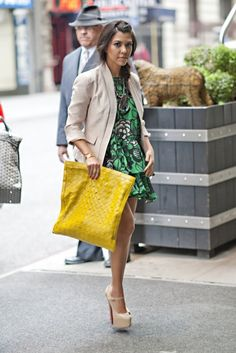 Kourtney Kardashian in Karen Zambos dress, H+M jacket, vintage clutch, Christian Louboutin shoes and a vintage necklace