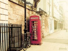 Oxford, England ~ I recently heard that all these old red phone booths in England are going to be sold to private buyers and will no longer be part of the English street scene.
