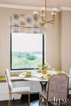 Inside a luminous Manhattan pied-a-terre with stunning views. Overlooking Carl Schurz Park, the breakfast nook showcases a Jonathan Adler chandelier over an Oly table. Vintage chairs from Jaydan Interiors are covered in fabric by Lee Jofa Threads. See more: http://www.luxesource.com.