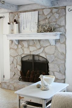 Painted stone fireplace before and after. I really need to do this to the family room fireplace.