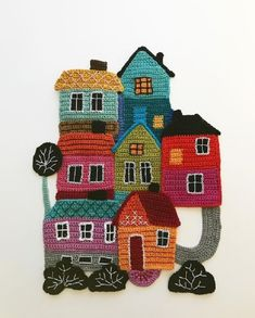 Freeform crochet art with overstitching by Tuija HeikkinenTuija Heikkinen groups together traditionally crocheted objects to tell stories.Freeform Crochet Uses Collage Techniques to Create Charming ArtHomely homes 🏠🏠🏠Solve A happy little cro Crochet Wall Art, Crochet Wall Hangings, Crochet Home, Crochet Crafts, Crochet Projects, Freeform Crochet, Crochet Motif, Crochet Designs, Crochet Flowers