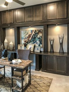 Home office with built in storage-and-display cabinets with Alder, shaker-style cabinet doors with OE5, IE2, FP1/4″ by TaylorCraft Cabinet Door Company in custom gray stain by cabinetmaker.