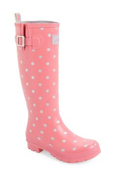 Fun pink and white polka dots decorate these adorable rain boots that add a feminine touch to any puddle proof ensemble.