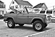 is it a Ford Bronco and a surfboard or a start to a perfect day...