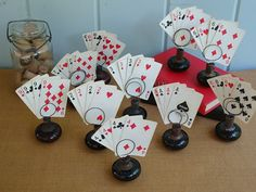 Wedding Table Numbers, Vintage Door Knobs and Playing Cards, Set of 10, Alice in Wonderland. $100.00, via Etsy.