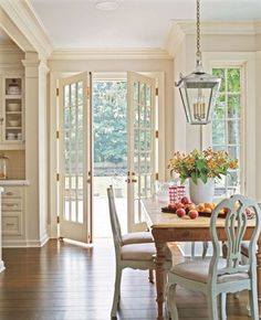 painted chairs with stained farmhouse table - old and new, fancy and everyday. love the mix n' match.