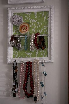 jewelry organizer - patterned paper as backdrop - could be changed out as decor and tastes change!