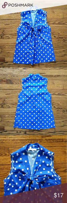 "Poema blue white polka dot tie sleeveless top Vibrant royal blue color with contrasting white polka dots. V-neck with tie at top. Sleeveless. Measurements are approx 32"" bust, 25"" length from top of shoulder to bottom hem. Excellent used condition. Poema Tops Tank Tops"