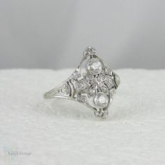 Art Deco Diamond Engagement Ring in White Gold. Circa 1920s. Two OEC diamonds 0.20ctw, 2.8 mm H - I, VS2 - SI1. Side 14 diamonds old mine cut or old single cut, 0.18ctw, H - K, SI. Size 6.25, 1,025.60.