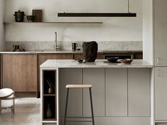 Nordic Archipelago by Nordiska Kök. A dark oak frame kitchen with hidden handles creates a warm and rustic feel in this Nordic archipelago inspired minimalist kitchen. The steel countertop, the kitchen island in light gray with Gotland limestone creates a Swedish Kitchen, Nordic Kitchen, Classic Kitchen, Timeless Kitchen, New Kitchen, Kitchen Ideas, Kitchen Decor, Kitchen Trends, Kitchen Tips