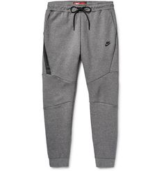 <a href='http://www.mrporter.com/mens/Designers/Nike'>Nike</a>'s sweatpants are designed for those who take lounging as seriously as training. Made from the label's high-performance cotton-blend Tech Fleece that is both lightweight and insulating, they're cut in a comfortable slim-tapered silhouette and have an oversized zipped pocket to keep small essentials secure. Wear yours post-gym or at the weekend.