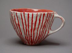 pinched cup with incised lines and red glaze lauren sandler