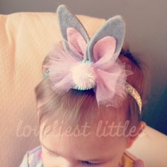 Soft, felt bunny shaped ears with tulle bow and pom on elastic. <> Gray with Light Pink Tulle Ivory with Lavender Tulle Only available as a headband.