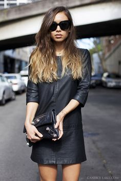 Simple three-quarter sleeve leather mini dress. Great edgy piece for the cooler months.