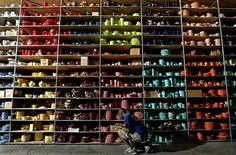 shelving filled with objects arranged by color