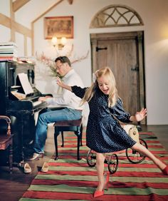 Plum Sykes Home | Toby plays the piano while Tess, age six, dances on a Moroccan rug. Photographed by François Halard, Vogue, November 2016.