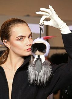 Cara Delevingne with the Fendi 'bag bug'. - Sale! Up to 75% OFF! Shop at Stylizio for women's and men's designer handbags, luxury sunglasses, watches, jewelry, purses, wallets, clothes, underwear & more!