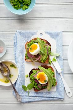 Toasted gluten-free bread with mashed peas, avocado, pickled onions, soft-cooked eggs, a pinch of sea salt and pepper.