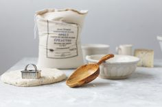 Flour, dough and wooden spoon by Herriott Grace