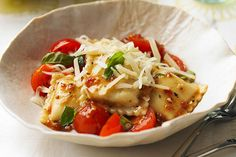 Cheese. Cherry tomatoes. Garlic and fresh basil. Sometimes, simplest really is best—as it is for the simple dressing for this cheese-filled ravioli pasta.