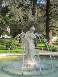 The statue in the park in the fountain in Bagni di Lucca. Province of Lucca , Tuscany