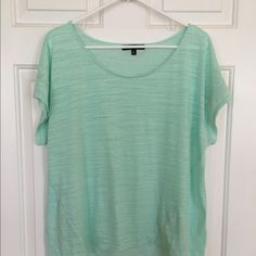 Women's Short Sleeved Top. XL Cute top, the fabric is a little see-thru, so you would need a cami underneath. Green Envelope Tops