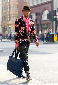 Ooo... Great style!  Pink ruffled shirt, floral jacket and those shoes!