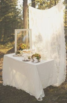 Make a backdrop for either the sign-in table or the tables of food at the reception to help close in the space for a sense of intimacy. Could also use the back-lit canvas idea for this