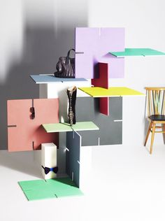 These shelves create dimension and functionality by being woven and locked together.
