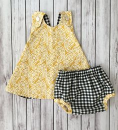 Best 11 Who wouldnt fall in love with this beautiful mustard yellow baby dress! The yellow pinafore baby dress is just perfect for the summer of fall with its reversible black and white checker baby dress reverse side. Your little one will easily have two Crochet Baby Dress Pattern, Baby Girl Dress Patterns, Little Girl Dresses, Baby Dresses, Peasant Dresses, Dress Girl, Sinclair, Baby Dress Design, Kids Frocks