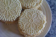 Meyer Lemon Pizzelle Cookies- Pizzelles were a family tradition at my grandparents house during the holidays. Im going to try the citrus twist instead of the traditional anise flavored ones. Lemon Pizzelle Recipe, Pizzelle Cookies, Pizelle Recipe, Pizzelle Maker, Almond Cookies, Chocolate Cookies, 13 Desserts, Cookie Desserts, Decorated Cookies