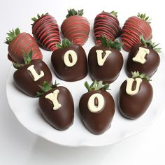"""'Love You' Choc Strawberries, An artisan-crafted confection. These chocolate-covered strawberries have been hand-dipped in dark Belgian Chocolate and drizzled in edible embellishments. With the words """"LOVE YOU"""" spelled out in white chocolate lettering,"""