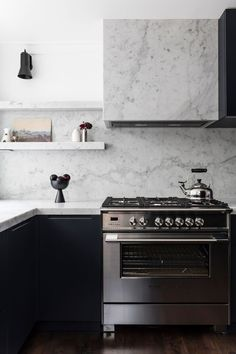 Real reno: Luxe materials star in Sydney terrace The home's new kitchen combines black cabinetry wit Kitchen Upstairs, New Kitchen, Kitchen Dining, Kitchen Ideas, Kitchen Hoods, Kitchen Cabinetry, Kitchen Designs, Kitchen Interior, Dining Room