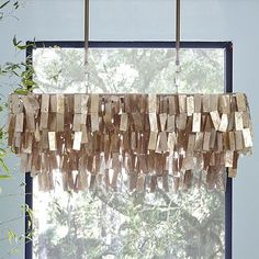 Would love to make a similar hanging lighting element for over the head table. Large Rectangular Capiz Pendant - Gold #westelm