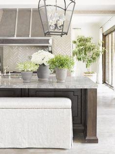 What's not to love? But I especially really love the backsplash, island and range hood with metal straps