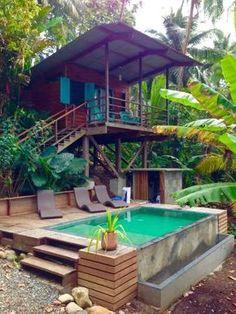 Pool area Bamboo House Design, Tropical House Design, Tropical Houses, Hut House, Jungle House, Home Decor Catalogs, Future House, Beautiful Homes, House Plans
