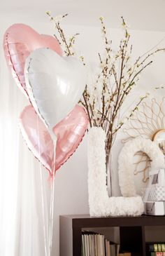 pink and grey girl baby shower with blossoming twigs, heart balloons from The…