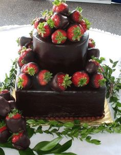 chocolate wedding cake covered in dipped strawberries - yum!