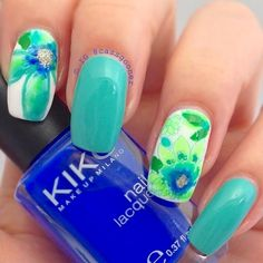 Blue green themed flower watercolor design. Use white and blue green polish as the alternating base color of the nails add blue green flowers on top and sprinkle sliver dust for added affect.
