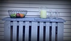 """Pinned it and did it! $9 DIY pallet patio bar.  Two pallets back to back, nailed together.   Painted with an """"oops"""" deck paint and topped with 4 pavers that were just over $2 each at home depot."""