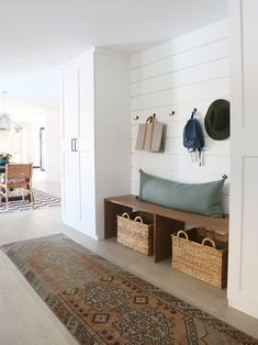 For those who are stomping indoors clad in muddy boots and other gardening garb and don't have a dedicated mudroom, check out blogger and interior designer Jenny Komenda's DIY, one-wall, Scandi-style solution.